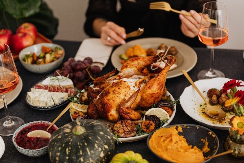 Table full of healthy Thanksgiving foods.