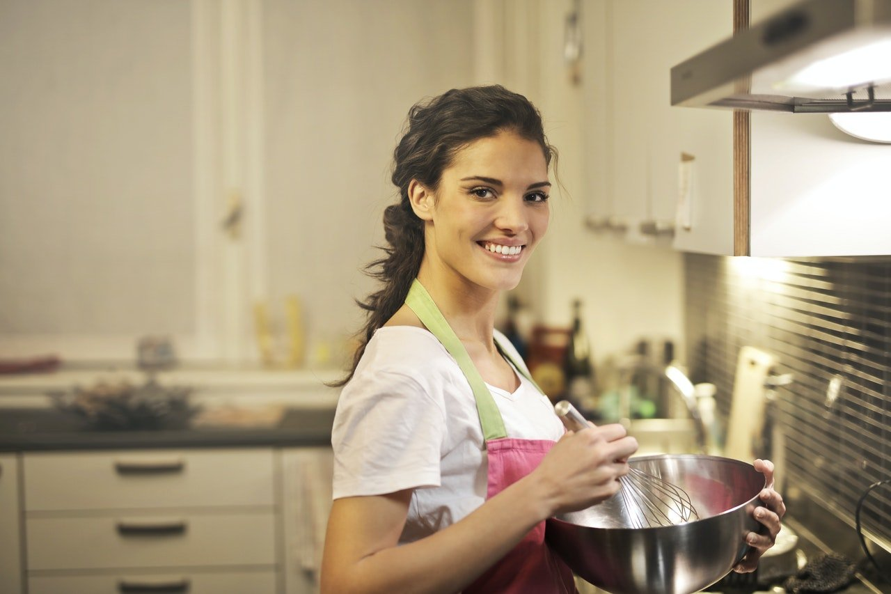 Woman cooking in kitchen.