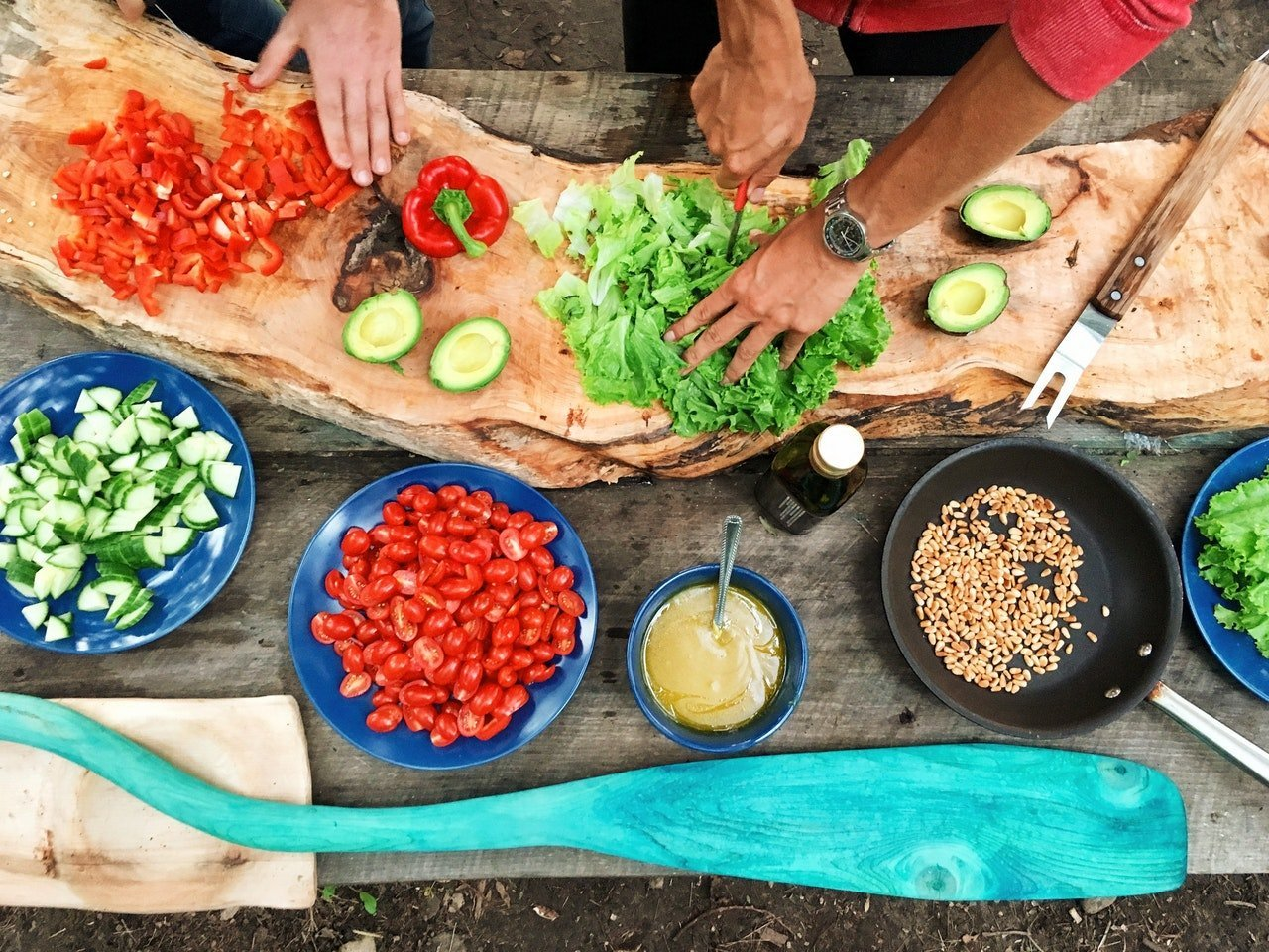 Home gardeners using fresh vegetables to create fresh and lean meals.