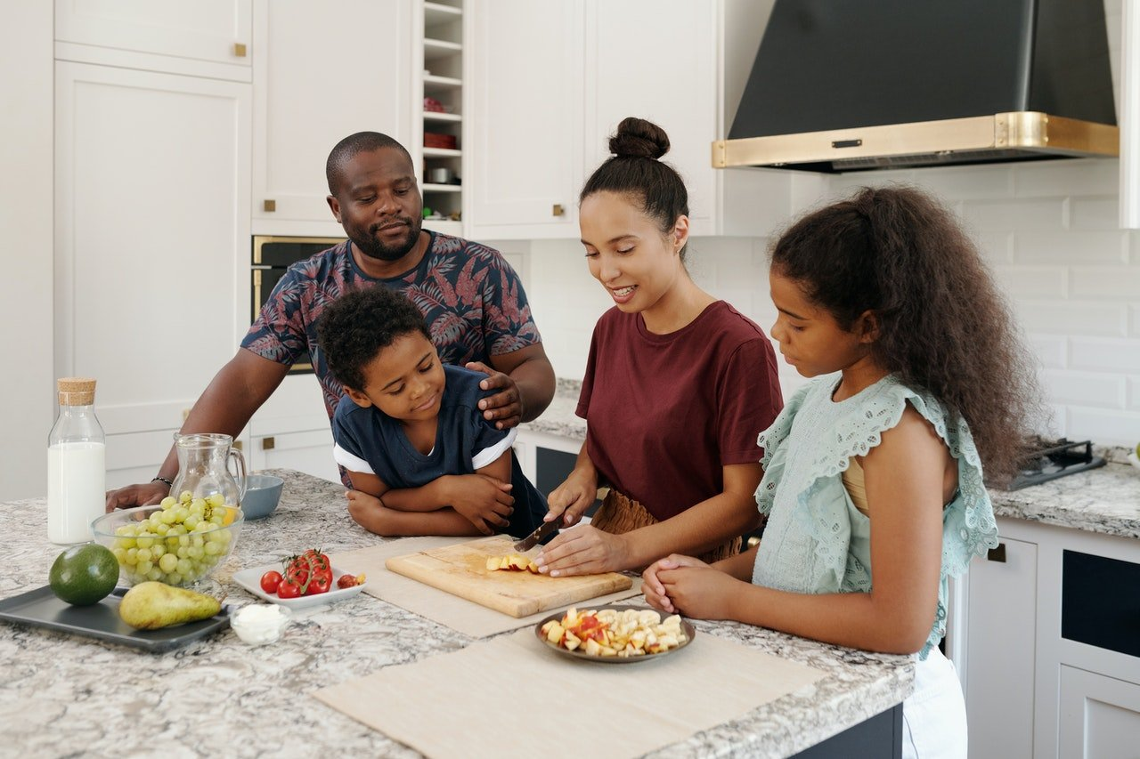 Young family making a healthy snack.