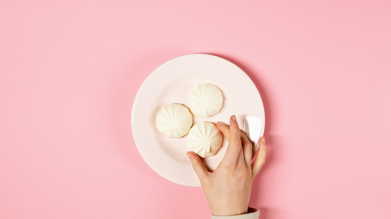 Hand reaching for sugar cookies.
