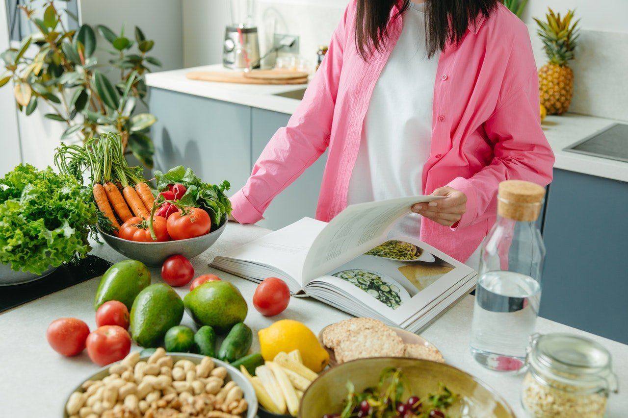 Nutritionist in kitchen designing a healthy meal plan.